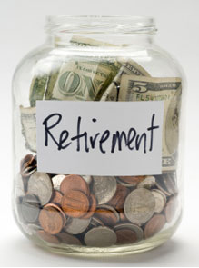 Benefits of using a 401k-Checkup 401(k) account retirement savings in a glass jar.